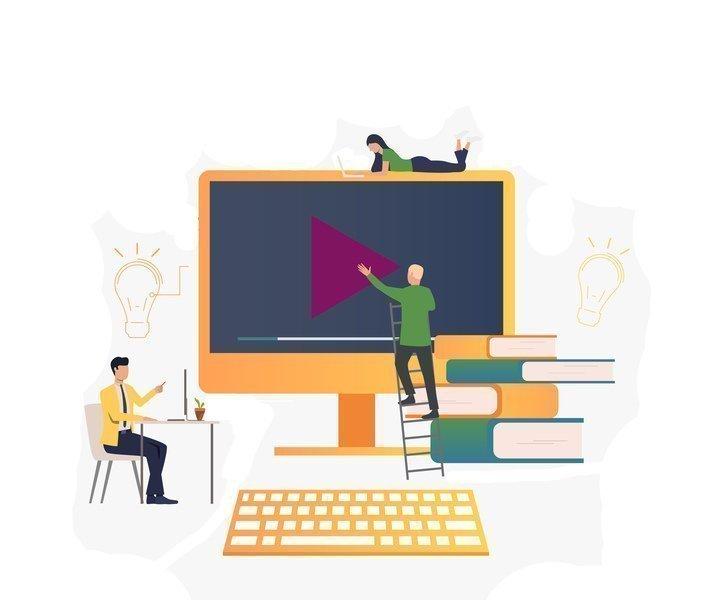 Imagem de dois homens e uma mulher em volta de um computador, rodeados por livros e símbolos de idéias.